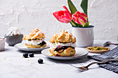 Cream puffs with soy whipped cream, blueberry compote and pistachios