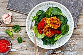 Vegetable pancakes with tomato sauce and spinach