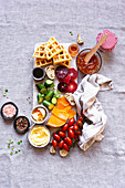 Sweet and Savory Breakfast Board with baguette, blood orange, butter, cheese, coffee, cucumber, gouda, honey, jam, waffles