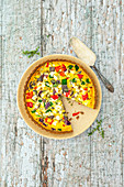 Gluten-free quiche with sweet potato flour, linseed flour, Mediterranean vegetables and feta