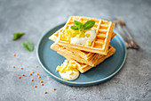 Gluten-free waffles made from red lentil flour with soy yogurt and pineapple salad