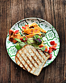Sandwich with pepper scrambled eggs, sprouts and avocado