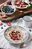 Breakfast table with porridge and fresh fruit