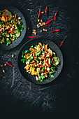 Mango and vegetable salad with peanuts and chilli