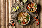 Variety of asian soups. Traditional spicy Thai tom yum kung and noodles soup with shiitake mushrooms, prawns