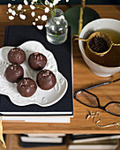 Energy balls with chocolate icing served with tea