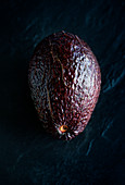 Avocado on a black stone background