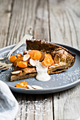 Cinnamon spiced almond dutch baby with honeyed kumquats, and a dollop of vanilla bean crème fraîche