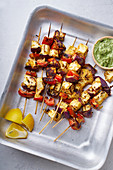 Grilled onion and pepper paneer skewers with peppermint sauce and lemon