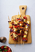 Grilled onion and pepper paneer skewers with tomato and cucumber salad