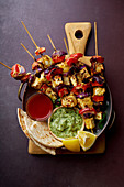 Grilled onion and pepper pan skewers with, flatbread, chilli and peppermint sauce