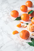 Fresh clementines on a marble surface