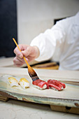 Nigiri sushi being made
