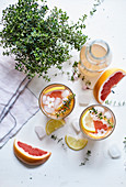 Grapefruit lemonade with thyme and lemon