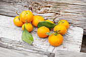 Freshly picked tangerines on a wooden background