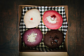 Four gourmet donuts in a box