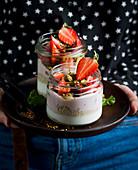 Yogurt with strawberries and pistachio