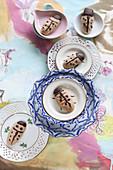 Gluten-free ladybird biscuits decorated with dark chocolate