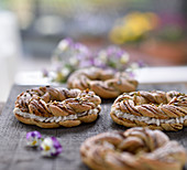 Vegan pistachio yeast dough wreaths filled with coconut and cream cheese frosting