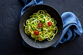 Homemade Zucchini Spaghetti with pesto sauce, broccoli and cherry tomatoes