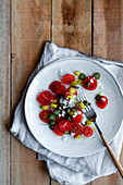 Cherry tomato salad with spring onions, chillis and capers