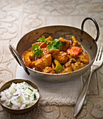 Chicken curry with red and green peppers and coriander