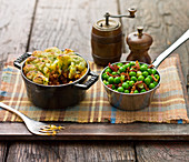 Shepherds pie, with a piped mash potato topping and garden peas with bacon bits