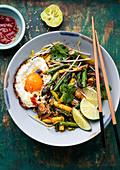 Stir-fried asparagus and mushrooms with a fried egg