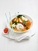 Chicken noodle soup with white thin noodles, Pak Choi, carrot, green chilli and coriander
