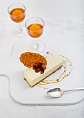 Vanilla cheesecake, with a honeycomb crisp, raisins, toffee sauce, with two glasses of sweet dessert wine