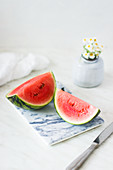 Watermelon wedges on a marble chopping board