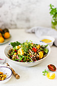 Quinoa salad with yellow tomatoes and fresh herbs