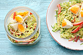 Leek salad with egg in a curry dressing to take away