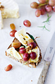 Cheese bread with camembert and red grapes