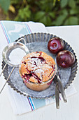 Plum cake baked in a glass with icing sugar