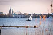A view of the Hamburg skyline with sailing boats in the foreground, Germany