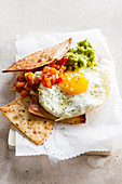 Chilaquiles fried tortillas with avocado cream