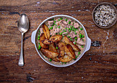 Creamy mushroom and tuna with peas and potato wedges
