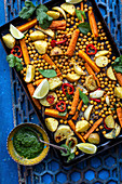 Roast potatoes with carrots, lime, coriander