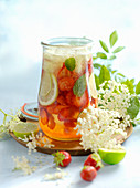 Strawberry punch with elderflower flowers