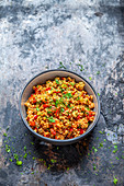 Buckwheat salad with red pepper and tomatoes