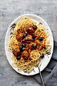 Spaghetti with Italian meatballs in olive tomato sauce