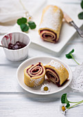 Swiss roll filled with sweet cherry jam
