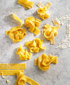 Pasta nests on a marble surface