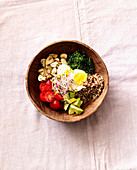 A savoury breakfast bowl with quinoa, egg and bean sprouts