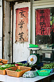 Chinese market stall of green vegetables