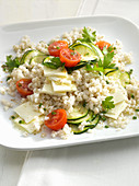 Mediterranean barley salad with feta cheese, cucumber and tomatoes