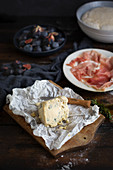 Blue cheese with prosciutto and figs
