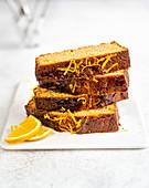 Syrup loaf cake with orange zest, sliced