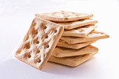Gluten-free crackers on white background